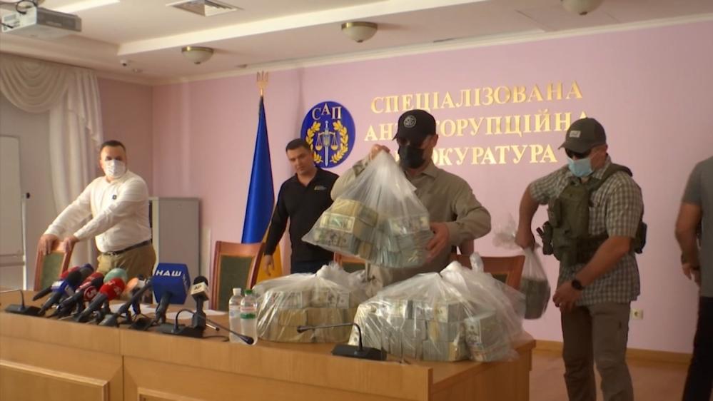 Ukrainian prosecutors display $6m they say was offered as a bribe to drop their long-running investigation into Mykola Zlochevsky and Burisma [Al Jazeera]